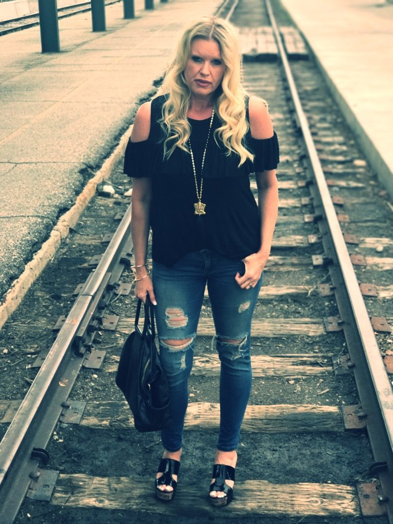 cold shoulder shirt with hobo bag on the railroad tracks