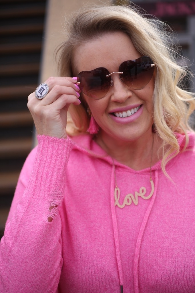 hot pink distressed sweater, love necklace, heart sunnies