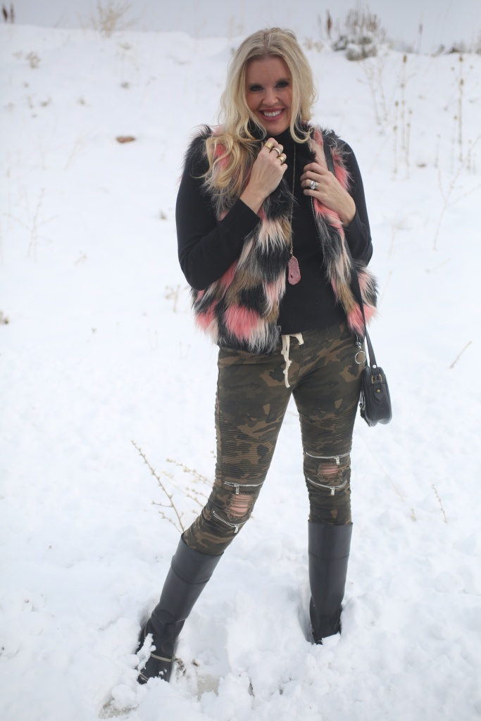 fur vest and camo pants
