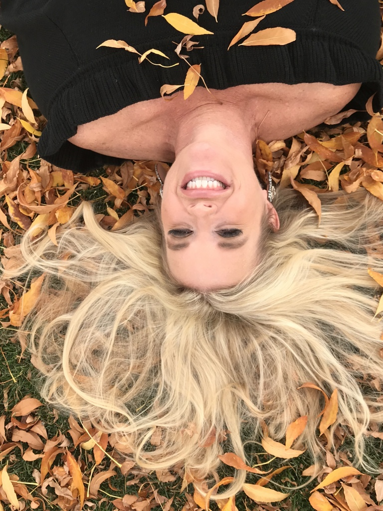 laying in fall leaves, blond hair